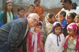 Anwar hugging kids